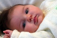 Gazing baby. Newborn baby gazing away on a sunny afternoon stock photos