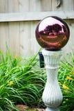 Gazing Ball in Garden stock photos