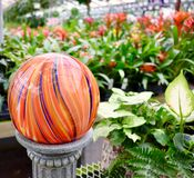 Gazing ball in orange. Gazing ball at the garden center royalty free stock photo