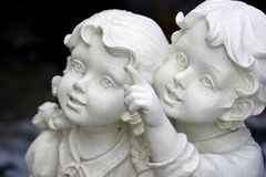 Gazing to the sky. Statue of children, boy pointing up for girl Royalty Free Stock Photo