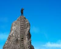 Gazing on top of rocky mountain Royalty Free Stock Photos