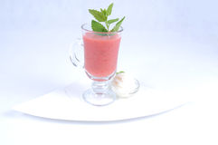 Gazpacho with lemon sorbet. Red fruit gazpacho served with a refreshing lemon sorbet Royalty Free Stock Photography