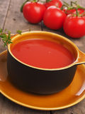 Gazpacho in a rustic bowl on a wooden table Stock Photography