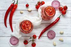 Gazpacho soup with fresh ingredients - three hot red chili peppers, onion rings, garlic and small cherry tomatoes Stock Photo