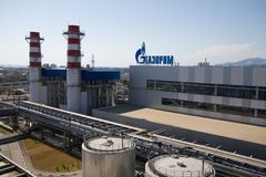 Gazprom company logo on the thermal power plant. ADLER, RUSSIA - JUNE 26, 2013: Gazprom company logo on the roof of thermal power plant Stock Photos