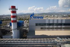 Gazprom company logo on the thermal power plant. ADLER, RUSSIA - JUNE 26, 2013: Gazprom company logo on the roof of thermal power plant Royalty Free Stock Photography