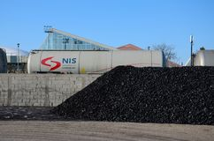 Gazprom liquid railway wagon carriage roll past pile of coal Belgrade Serbia. Belgrade, Serbia - March 20, 2015: Railways wagons of one of Russia's largest oil Royalty Free Stock Photo