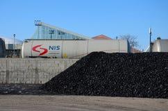 Gazprom liquid railway wagon carriage roll past pile of coal Belgrade Serbia Royalty Free Stock Photo