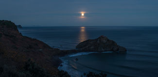 Gaztelugatxe hermitage under the light of the moon at night Royalty Free Stock Photos
