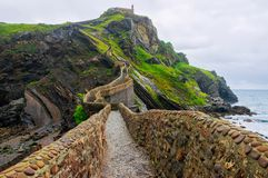 Gaztelugatxe. Spain. Basque Country . Beautiful landscape islet on the coast of Biscay. Solid stone bridge, and going up 241 steps royalty free stock photography