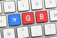 GB writing on white keyboard with a aircraft sketch Stock Photos