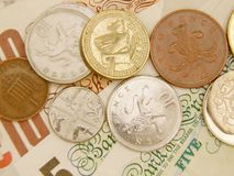 GBP banknotes and coins. British Sterling pound currency - legal tender of the United Kingdom Union - banknotes and coins Stock Photos