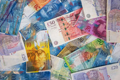 GBP and CHF banknotes as background Stock Photo