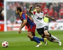 GBR: Football Champions League Final 2011. LONDON, ENGLAND. May 28 2011: Barcelona's midfielder Javier Mascherano and Manchester's midfielder Ryan Giggs during royalty free stock photography