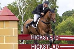 GBR: L'equites Hickstead salta il derby 2011 Immagini Stock Libere da Diritti