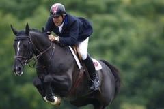 GBR: O cavaleiro Hickstead salta o derby 2011 Imagens de Stock Royalty Free