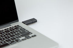 16 gbusb stick plugged on right side of laptop Stock Photography