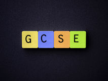 GCSE. Tiled Letters. GCSE, examinations, in colourful tiled letters. On textured grey paper with craquelure effect Stock Photography