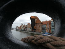 Gdańsk view through the hole, Poland/ Gdansk. The crane in Gdańsk seen from ship `Soudek`.  This is the  oldest surviving port crane in Europe XV century Stock Photography