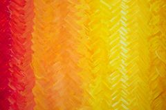 Gdaddientny background with visible brush strokes. Brush strokes form herringbone pattern. A beautiful smooth transition from red to yellow and back royalty free stock photos