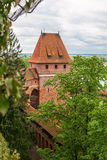 Gdanisko - One of the towers of a medieval castle. Malbork. Pola Stock Images