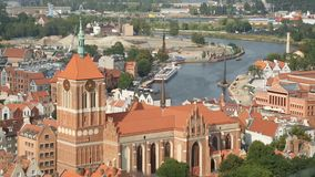 Gdansk aerial cityscape, gothic architecture of medieval Saint Johns Church. Stock footage stock footage