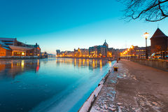 Gdansk at dusk. Old town in Gdansk with frozen Motlawa river at dusk, Poland Stock Photos