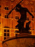 Gdansk by night. Night scene of old town with Neptune statue; Gdansk, Poland stock image