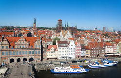 Gdansk old city panorama. Gdansk Old City in Poland with the Green Gate, City Hall, Cathedral and tourist ships Stock Photography