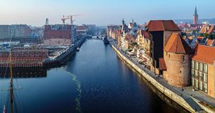 Gdansk old city, Poland. Aerial view with old crane, Motlawa. Gdansk, Poland. Old city with the oldest medieval port crane Zuraw in Europe, town hall tower Stock Photo