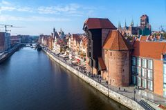 Gdansk old city, Poland. Aerial view with old crane and river. Gdansk old city in Poland with the oldest medieval port crane Zuraw in Europe, St Mary church Stock Photo