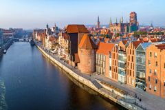 Gdansk old city, Poland. Aerial view at sunrise. Gdansk old city in Poland with the oldest medieval port crane Zuraw in Europe, St Mary church, Town hall tower Stock Image