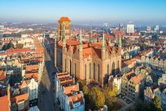 Gdańsk, Poland. Old city with St. Mary cathedral. Gdansk old city in Poland with medieval Gothic Saint Mary Cathedral . Aerial view in sunrise light. Early stock photos