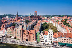 Gdansk old city skyline, Poland. Gdansk Old City in Poland with Gothic St Mary church, Mariacka Gate, City Hall tower, historical houses and the promenade along Stock Photos