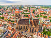 Gdansk - old town from the air. Landscape of Gdansk with St Mary`s Basilica. Tourist attractions and monuments of cities of Gdansk seen from the air. Photos of stock image