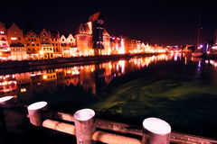 Gdansk old town and famous crane. Historic center of Gdansk. Gdansk old town and famous crane, Polish Zuraw. View from Motlawa river. Poland at romantic night Royalty Free Stock Photography