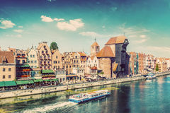 Gdansk old town and famous crane, Polish Zuraw. Motlawa river in Poland. Vintage Stock Photography
