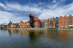 Gdansk old town and famous crane, Polish Zuraw. View from Motlawa river, Poland at romantic sunset, night. The city also known as Danzig and the city of amber Royalty Free Stock Image
