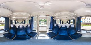 GDANSK, POLAND - AUGUST, 2018: panorama 360 degrees angle view in interior of budget passenger railway carriage in equirectangular royalty free stock photography