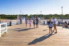 People on the sunny beach of Baltic Sea in Gdansk Brzezno. GDANSK, POLAND - AUGUST 14, 2017: People on the sunny beach of Baltic Sea in Gdansk Brzezno. Gdansk is Royalty Free Stock Image
