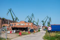 GDANSK, POLAND - AUGUST, 2018 : Gdansk Shipyard by Vistula river, the birthplace of polish Solidarity/ A view of shipyard and the stock image