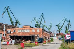 GDANSK, POLAND - AUGUST, 2018 : Gdansk Shipyard by Vistula river, the birthplace of polish Solidarity/ A view of shipyard and the royalty free stock photo
