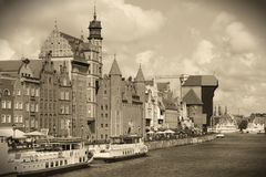Gdansk, Poland. Poland - Gdansk city (also know nas Danzig) in Pomerania region. Old town view with Motlawa river and famous Crane. Sepia tone old style image Stock Image