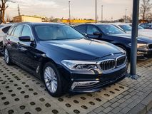BMW display cars at the car showroom of Gdansk, Poland. BMW is a German automobile, motorcycle. Gdansk, Poland - February 8, 2019: New model of BMW 5 series at stock images