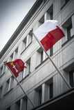 Gdansk and Poland flags flying from Gdansk building. Flag of Gdansk city in northern Poland flying alongside national flag Stock Photo