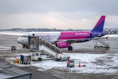 Preparing for boarding to Wizz air plane on Lech Walesa Airport royalty free stock photo