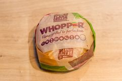 Whopper sandwich in paper from Burger King. Gdansk, Poland - January 11, 2018: Whopper sandwich in paper from Burger King stock photography