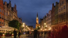 Time lapse of tourists walking at Long Market street in Gdansk at night stock video