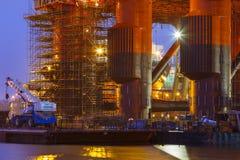 Oil Platform in the shipyard at maintenance. Gdansk, Poland- March 24, 2014: Oil Platform Scandinavia in the shipyard for maintenance at night Royalty Free Stock Images