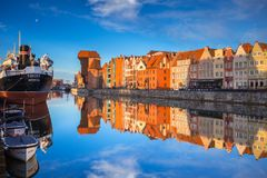 Old town of Gdansk reflected in the Motlawa river at sunrise, Poland. Royalty Free Stock Image